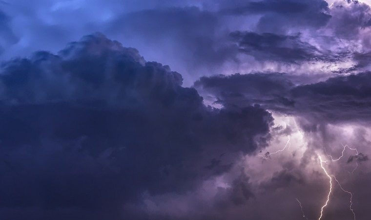 Purple clouds in the sky with a bold of lightening