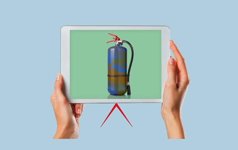 Hands holding a tablet device containing an image of a fire extinguisher with the print of the world on
